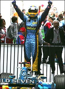 Fernando Alonso stands on his car in joy in parc ferme after the Australian Grand Prix