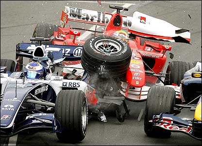 Nico Rosberg's Williams, Felipe Massa's Ferrari and Christian Klien's Red Bull tangle at the first corner