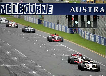 Jenson Button fends off Kimi Raikkonen early in the Australian Grand Prix