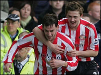 Rory Delap (l) is congratulated by team-mates after scoring Sunderland's equaliser