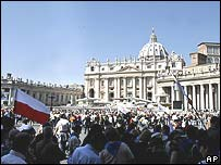 Crowds, some waving Polish flags, gather in St Peter's Square to remember Pope John Paul II