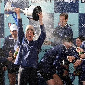 Oxford president Barney Williams raises the Boat Race trophy above his head