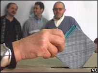 Woman voting in an Italian election