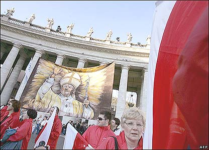 Polish pilgrims holding a picture of John Paul on St Peter square at the Vatican