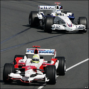 Ralf Schumacher's Toyota finishes just ahead of Nick Heidfeld's BMW Sauber