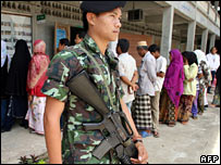 Soldier guards a polling station in the south