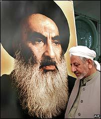 Man walking past picture of Grand Ayatollah Sistani