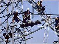 Engineers work on a pylon in Italy