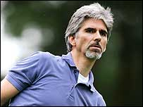 Damon Hill watches his shot during a Pro-Am golf event in 2005