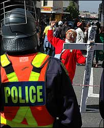 Jacob Zuma supporter in front of police (Pic: Jonathan Biles)