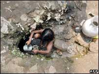 Bangladeshi girl collecting drinking water, AFP/Getty