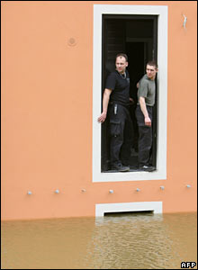 Two men observe the rising water of the River Elbe in Messen, eastern Germany