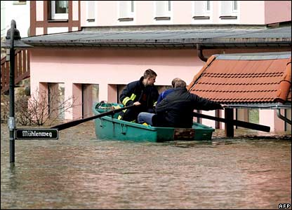 Rescues evacuate residents from the flooded town of Rathen, eastern Germany