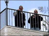 Israeli settlers or security guards on the rood of a property in east Jerusalem