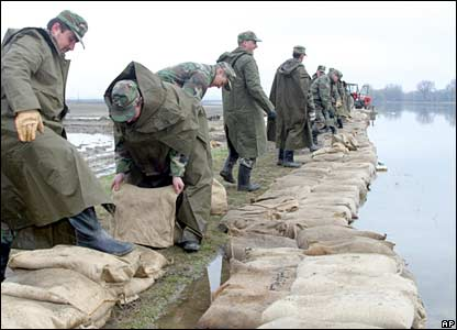 Slovakian soldiers build a barrier from nearly 80,000 sand bags at the embankment of flooded Cierna Voda river near Trstice, western Slovakia