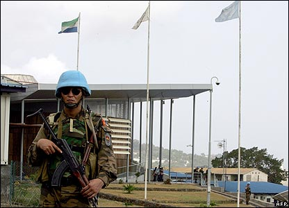 A UN peace-keeping soldier stands guard outside the tribunal building
