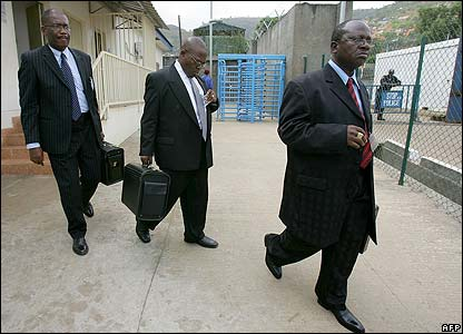 Lawyers for Mr Taylor arrive at the tribunal