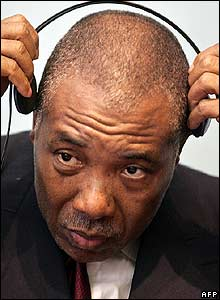 Charles Taylor adjusts his earphones in court
