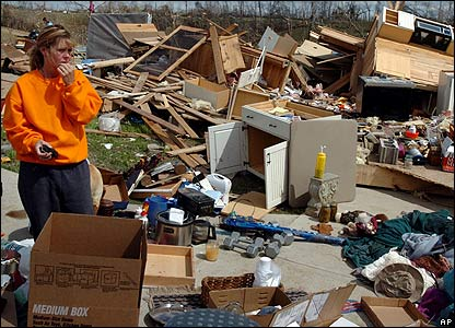 Resident Lisa Scott takes in the devastation in Millsfield, Tennessee