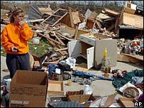 Resident Lisa Scott looks at devastation in Millsfield, Tennessee