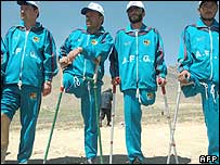 A group of Afghan athletes who lost their legs to mines take part in a ceremony to mark the international awareness day