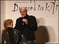 Sean Connery and wife on stage