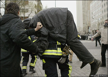 Fireman evacuates a wounded protester in Paris