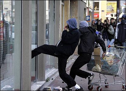 Youths smash a shop front in Lille