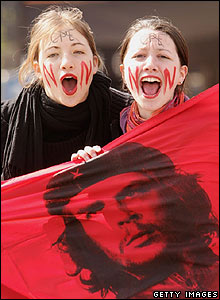 French student protesters hold a Che Guevara flag in Paris