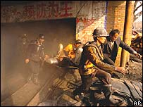 A miner being rescued from a fire in the city of Shahe in north China's Hebei Province in November 2004