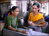 Women in Mumbai snack shop
