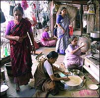 Indian women preparing food