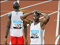 Marlon Devonish (L) and Mark Lewis-Francis stumble at the Commonwealth Games