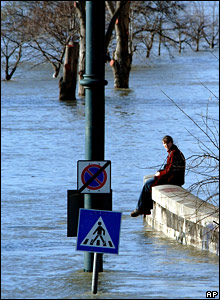 Girl sits on the banks of the Danube