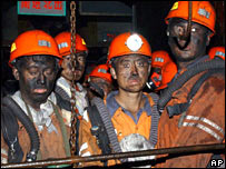 Rescuers at a mine in central China after a blast in October 2005