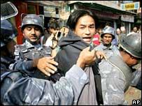 Police arrest a protester in Kathmandu, Nepal, 5 April 2006
