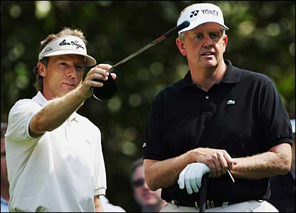 Bernhard Langer points the best way to the green to Colin Montgomerie