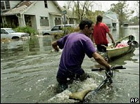 Men wade through the floods in New Orleans