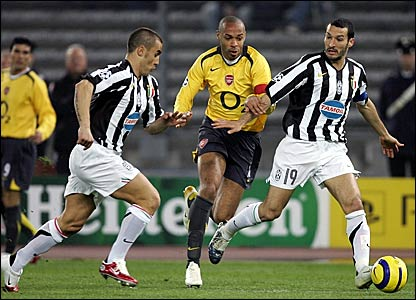 Thierry Henry (centre) chases a through ball