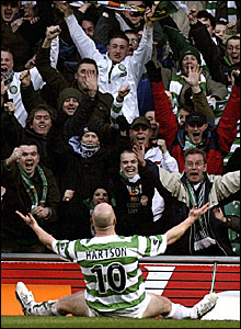 Celtic striker John Hartson milks the applause after scoring early on