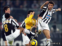 Arsenal's Cesc Fabregas battles with Juventus' Adrian Mutu