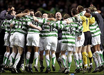 Celtic players celebrate winning the SPL title