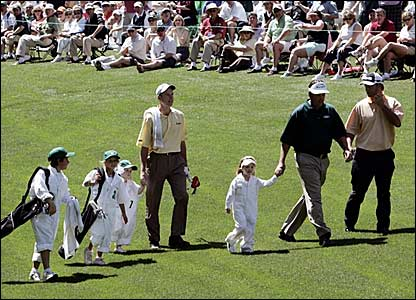 (l-r) Jim Furyk, Phil Mickelson and Chris DiMarco walk the fairways with their children