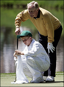 Former Masters champion Jack Nicklaus and grandson Charlie study a putt