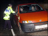 Police officer stopping traffic at Cellardyke near Fife, Wednesday 5 April 2006