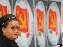 A nun next to communist posters