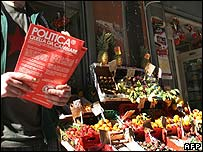 Communist leaflet outside fruit stall