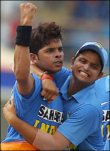 Sri Sreesanth celebrates his wicket with Suresh Raina
