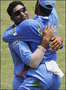 Yuvraj Singh claims the wicket of Collingwood to break a partnership of 90 runs
