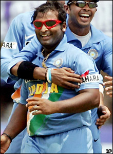 Ramesh Powar celebrates as England lose their sixth wicket